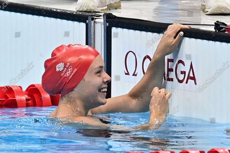 Anna Rose Hopkins (GBR) celebrates at the end of the Mixed 4 x 100m medley relay final, in which the GBR team set a new world record.
