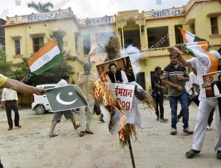 Stock Picture of Lok Janshakti Party Ramvilas activists demonstrating and burning effigy of Pakistani Prime Minister Imran Khan in protest against the recent killing of Bihari by terrorists in Kashmir, at Bihar Hindi Sahitya Sammelan campus on October 18, 2021 in Patna, India.