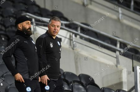 Manager Darren Ferguson of Peterborough United takes a look at the MKM stands before the game as he will sit up top