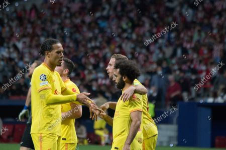 Stock Image of Mohamed Salah (R) clebrates his second goal whit Virgil Van Dijk (L). More than 55.000 people comes to see the match between Atlético de Madrid and Liverpool, Griezmann twice and Mohamed Salah two times too, makes the majority of the goals, for a match which the final score was 2 to 3 whit victory of Liverpool.