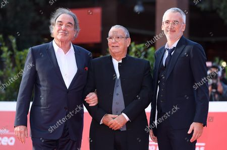 Oliver Stone (L), Italian composer Carlo Siliotto (C) and Ukraine's director Igor Lopatonok arrive for the screening of 'Qazaq. History of the Golden Man' poses at the 16th annual Rome International Film Festival, in Rome, Italy, 20 October 2021. The Festa Del Cinema Di Roma runs from 14 to 24 October.