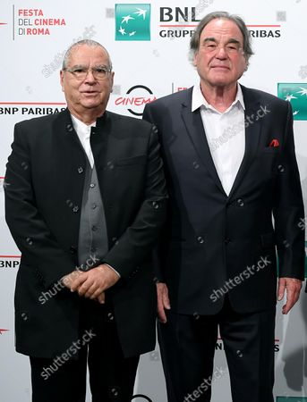 Carlo Siliotto (L) and US director and producer Oliver Stone pose during a photocall for the movie 'Qazaq. History of the Golden Man' at the 16th annual Rome International Film Festival, in Rome, Italy, 20 October 2021. The Festa Del Cinema Di Roma runs from 14 to 24 October.