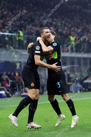 Edin Dzeko of Fc Internazionale celebrates after scoring his team's first goal during the Uefa Champions League Group D match between FC Internazionale and FC Sheriff.