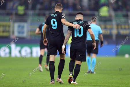 Edin Dzeko of Fc Internazionale celebrates after scoring his team's first goal with team mate Lautaro Martinez during the Uefa Champions League Group D match between FC Internazionale and FC Sheriff.