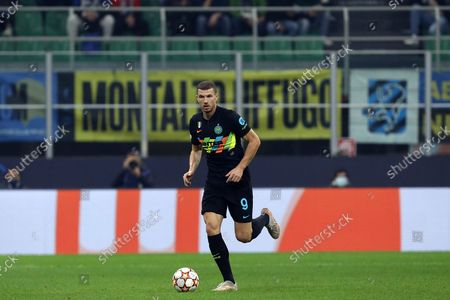 Stock Photo of Edin Dzeko of Fc Internazionale controls the ball during the Uefa Champions League Group D match between FC Internazionale and FC Sheriff.