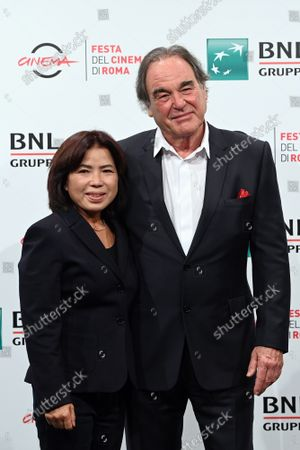 The director Oliver Stone with wife Sun-jung Jung
