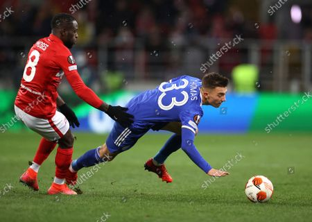 Spartak's Victor Moses, left, challenges for the ball with Leicester's Luke Thomas during the Europa League Group C soccer match between Spartak Moscow and Leicester City at the Otkritie Arena, in Moscow, Russia