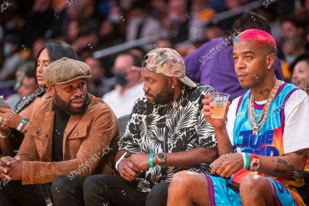 Stock Photo of Boxer Floyd Mayweather Jr., left, and rapper, Kid Cudi, right, attends a game between the Golden State Warriors and the Los Angeles Lakers on October 19, 2021 at Staples Center in Los Angeles.