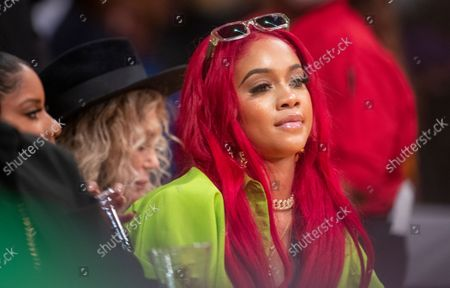 Rapper Saweetie attends a game between the Golden State Warriors and the Los Angeles Lakers on October 19, 2021 at Staples Center in Los Angeles.