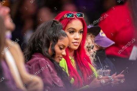 Stock Image of Rapper Saweetie attends a game between the Golden State Warriors and the Los Angeles Lakers on October 19, 2021 at Staples Center in Los Angeles.