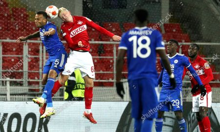 Stock Picture of Ruslan Litvinov (2-L) of Spartak Moscow in action against Ryan Bertrand (L) of Leicester during the UEFA Europa League group C soccer match between FC Spartak Moscow and Leicester City in Moscow, Russia, 20 October 2021.