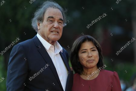 """Director Oliver Stonel, left, poses with his wife Sun Jung Jung on the red carpet for the movie """"Qazaq: History of the Golden Man"""", at the 16th edition of the Rome Film Fest in Rome"""