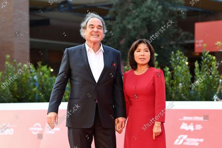 Oliver Stone with wife Sun-jung Jung