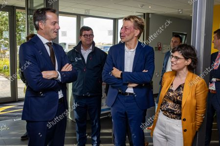 Stock Image of Prime Minister Alexander De Croo, Oostende's Mayor Bart Tommelein, ELIA CEO Chris Peeters and Energy minister Tinne Van der Straeten pictured during the inauguration of the first zone of an offshore wind farm in the North Sea, Wednesday 20 October 2021 in Oostende.