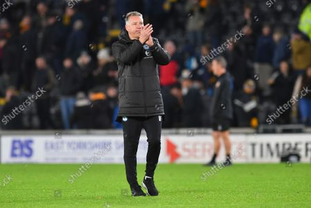 Peterborough United Manager Darren Ferguson  (m) celebrates with fans at the end of the match the EFL Sky Bet Championship match between Hull City and Peterborough United at the MKM Stadium, Kingston upon Hull