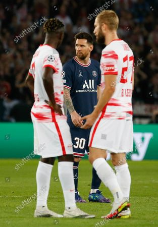 Stock Picture of PSG's forward Lionel Messi (background) looks on during the UEFA Champions League first round Group A football match between Paris Saint-Germain's (PSG) and RB Leipzig, at The Parc des Princes stadium, in Paris, FRANCE - 19/10/2021.