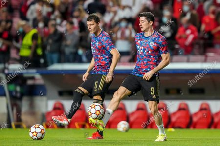 Bayern's Robert Lewandowski, right, and Bayern's Benjamin Pavard warm up during the Champions League group E soccer match between Benfica and Bayern Munich at the Luz stadium in Lisbon