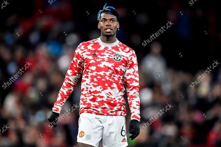 Manchester United's Paul Pogba reacts as he warms up prior to the UEFA Champions League group F soccer match between Manchester United and Atalanta BC in Manchester, Britain, 20 October 2021.