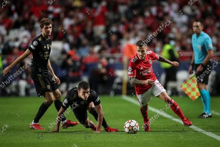 Benfica player Grimaldo (R) in action with Bayern Munich player Benjamin Pavard (C)  during the UEFA Champion League group E soccer match between Benfica Lisbon and Bayern Munich, in Lisbon, Portugal, 20 October 2021.