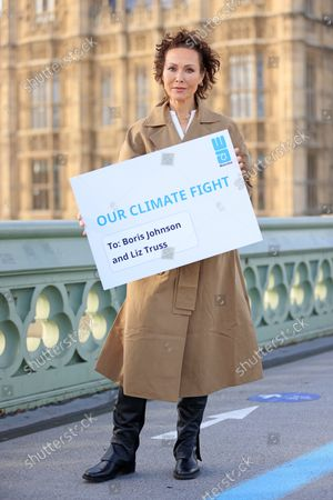 Stock Picture of Actor and director Amanda Mealing joined WaterAid at Whitehall today wearing a specially designed jacket with the words 'Water can't wait', to present an open letter to the UK Government urging them to ensure vulnerable communities have clean water so they can protect themselves from the effects of climate change. She is joined by Fleur Anderson, MP and co-chair of the WASH and Lord Bates.The letter, which was signed by over 19,000 people from across the UK, was addressed to Boris Johnson and Liz Truss, Secretary of State for Foreign, Commonwealth and Development Affairs and MP for south west Norfolk.  Together, they are calling on the UK Government to invest one-third of the UK's committed international climate funding on locally-led adaptation projects, which will help vulnerable communities get the essentials like a reliable source of clean water to better adapt to climate change.New figures from a poll commissioned by WaterAid found that half the UK population support giving money to poorer nations to help them cope with the impacts of climate change. Two in five Brits (40 per cent) think the UK's influence and standing in the world would take a hit if the UK Government failed to meet its commitments to developing countries on climate change.