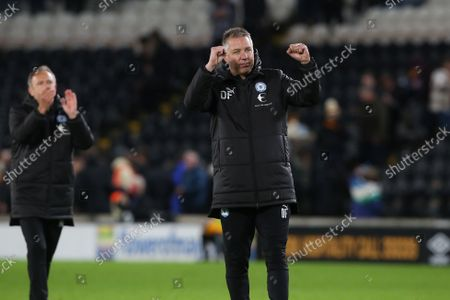 Peterborough United Manager Darren Ferguson celebrates the victory at full-time