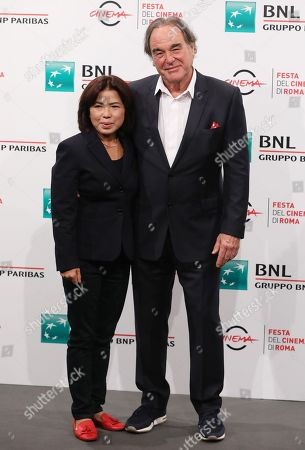 Stock Photo of Oliver Stone and his wife Sun-jung Jung