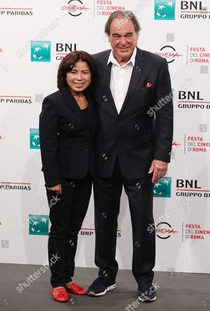 Oliver Stone and his wife Sun-jung Jung