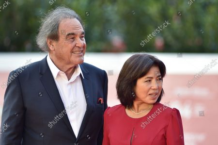 """Oliver Stone and Sun-jung Jung attend the red carpet of the movie """"JFK - Destiny Betrayed"""" and """"Qazaq. History Of The Golden Man"""" during the 16th Rome Film Fest 2021 on October 20, 2021 in Rome, Italy."""