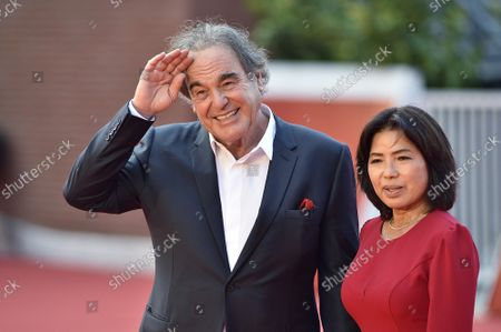 """Stock Image of Oliver Stone and Sun-jung Jung attend the red carpet of the movie """"JFK - Destiny Betrayed"""" and """"Qazaq. History Of The Golden Man"""" during the 16th Rome Film Fest 2021 on October 20, 2021 in Rome, Italy."""