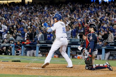 Stock Image of Los Angeles Dodgers' Justin Turner, left, celebrates after scoring a run off a two-run single by AJ Pollock past Atlanta Braves catcher Travis d'Arnaud during the fifth inning in game four in the 2021 National League Championship Series at Dodger Stadium on Wednesday, Oct. 20, 2021 in Los Angeles, CA. (Robert Gauthier / Los Angeles Times)