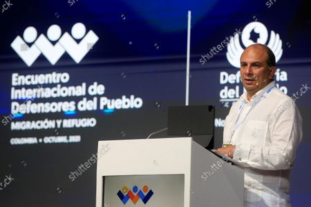 """The Colombian Ombudsman, Carlos Camargo, speaks during the first day of the International Ombudsmen Meeting in Cartagena, Colombia, 20 October 2021. Camargo assured during the summit that """"the other emergency in Latin America is the passage of transcontinental and Caribbean migrants from Asia, Africa, Europe and Latin America seeking to reach the northern countries of the hemisphere"""". He explained that in many cases they are people persecuted for their race, sexual orientation and gender identity, religion, nationality, belonging to a social group or because of their political opinions, or also, due to poverty."""