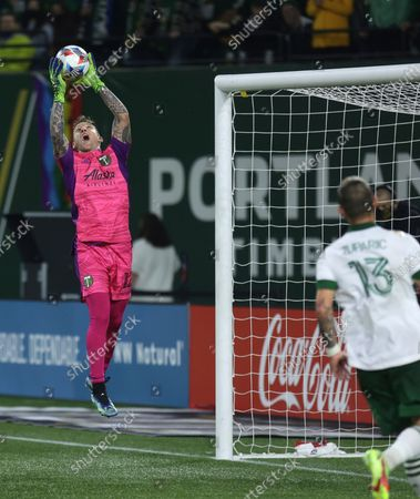 Stock Image of Portland Timbers goalkeeper Steve Clark makes a save against the Vancouver Whitecaps during the first half of an MLS soccer match in Portland, Ore