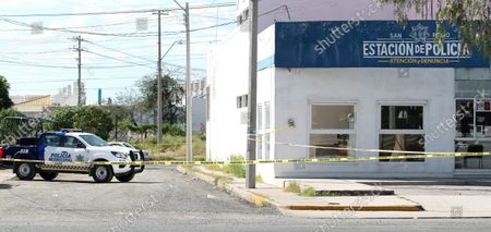 Municipal police officers guard the scene of an attack on a police station in the city of Leon, Guanajuato state, Mexico, 20 October 2021. On the afternoon of 20 October an armed group attacked a couple of police booths.