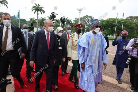 Stock Picture of (211020) - ABUJA, Oct. 20, 2021 (Xinhua) - Nigerian President Muhammadu Buhari (R, front) welcomes Turkish President Recep Tayyip Erdogan (L, front) in Abuja, Nigeria, on Oct. 20, 2021. Buhari and Erdogan, on Wednesday oversaw the signing of eight bilateral agreements on such areas as energy, defense industry, mining and hydrocarbons during their meeting in the Nigerian capital.