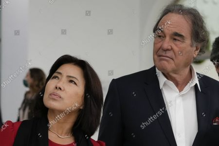American screenwriter, film director, and producer Oliver Stone and his wife Sun-jung Jung arrive on the occasion of the screening of the documentary JFK - Destiny Betrayed at the 16th edition of the Rome Film Fest in Rome