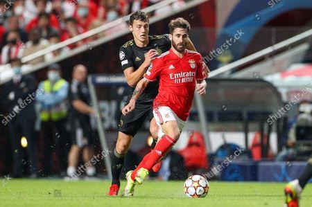 Benjamin Pavard #5 (FC Bayern Munich) and Rafa Silva #27 (Benfica Lisbon)