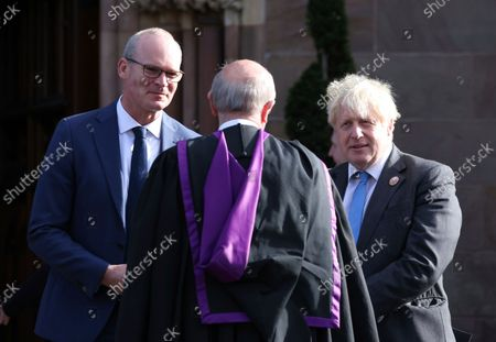 Stock Image of British Prime Minister Boris Johnson and Simon Coveney TD Minster for Foreign Affairs (Ireland) attend St Patrick's Church of Ireland Cathedral in Armagh,. The Prime Minister was joined over 150 guests at a church service to mark the centenary of partition and the formation of Northern Ireland