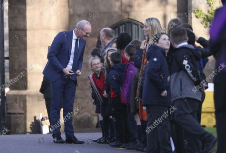 Irish Minister for Foreign Affairs Simon Coveney greets children as he arrives at St. Patrick's Church of Ireland Cathedral in Armagh,. Coveney joined over 150 guests at a church service to mark the centenary of partition and the formation of Northern Ireland