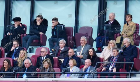 Sir Trevor Brooking looks on in front of David Sullivan and David Gold