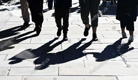 Shadows are cast across the street in London, Britain, 21 October, 2021. The UK government is under pressure to implement its Covid Plan B as figures have shown that England is recording some fifty thousand Covid-19 cases daily, the highest number since mid-July.