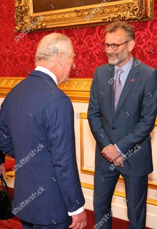 Prince Charles meets Hugh Dennis during the Prince's Trust Awards Trophy Ceremony at St James Palace on October 21, 2021 in London, England. The Prince's Trust Awards recognize young people who have succeeded against the odds, improved their chances in life and had a positive impact on their local community.