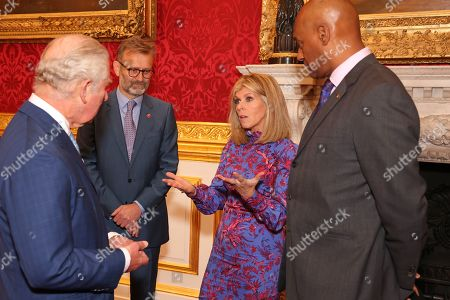 Prince Charles, Hugh Dennis, Kate Garraway and Colin Salmon attend the Prince's Trust Awards Trophy Ceremony at St James Palace on October 21, 2021 in London, England. The Prince's Trust Awards recognize young people who have succeeded against the odds, improved their chances in life and had a positive impact on their local community.