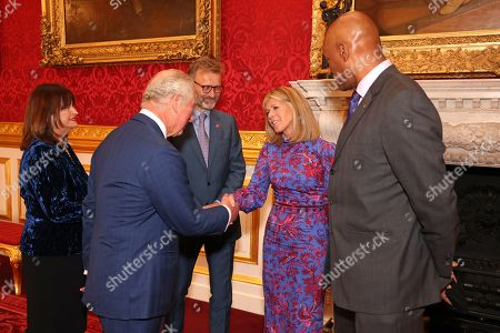 Head of Ambassadors at Prince's Trust, Annie Lycett, Prince Charles, Hugh Dennis, Kate Garraway and Colin Salmon attend the Prince's Trust Awards Trophy Ceremony at St James Palace on October 21, 2021 in London, England. The Prince's Trust Awards recognize young people who have succeeded against the odds, improved their chances in life and had a positive impact on their local community.