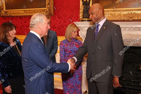 Head of Ambassadors at Prince's Trust, Annie Lycett, Prince Charles, Kate Garraway and Colin Salmon attend the Prince's Trust Awards Trophy Ceremony at St James Palace on October 21, 2021 in London, England. The Prince's Trust Awards recognize young people who have succeeded against the odds, improved their chances in life and had a positive impact on their local community.