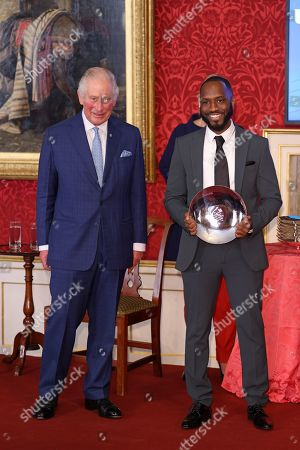 Prince Charles presents The Watches of Switzerland Group Young Change Maker award to Cordell Jeffers during the Prince's Trust Awards Trophy Ceremony at St James Palace on October 21, 2021 in London, England. The Prince's Trust Awards recognize young people who have succeeded against the odds, improved their chances in life and had a positive impact on their local community.
