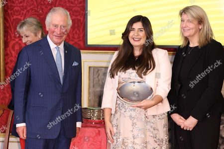 Prince Charles presents the Winner of the NatWest Enterprise Award, Noor Kimit during the Prince's Trust Awards Trophy Ceremony at St James Palace on October 21, 2021 in London, England. The Prince's Trust Awards recognize young people who have succeeded against the odds, improved their chances in life and had a positive impact on their local community.