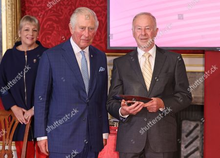 Stock Picture of Prince Charles and Volunteer of the Year in association with GMB, Neal Clements during the Prince's Trust Awards Trophy Ceremony at St James Palace on October 21, 2021 in London, England. The Prince's Trust Awards recognize young people who have succeeded against the odds, improved their chances in life and had a positive impact on their local community.