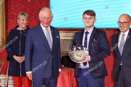 Prince Charles presents the Ascential Educational Achiever Award to Aidan Sayers during the Prince's Trust Awards Trophy Ceremony at St James Palace on October 21, 2021 in London, England. The Prince's Trust Awards recognize young people who have succeeded against the odds, improved their chances in life and had a positive impact on their local community.