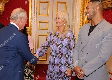 Prince Charles, Gaby Roslin and Tyler West during the Prince's Trust Awards Trophy Ceremony at St James Palace on October 21, 2021 in London, England. The Prince's Trust Awards recognize young people who have succeeded against the odds, improved their chances in life and had a positive impact on their local community.