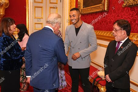 Prince Charles shakes hands with Tyler West during the Prince's Trust Awards Trophy Ceremony at St James Palace on October 21, 2021 in London, England. The Prince's Trust Awards recognize young people who have succeeded against the odds, improved their chances in life and had a positive impact on their local community.